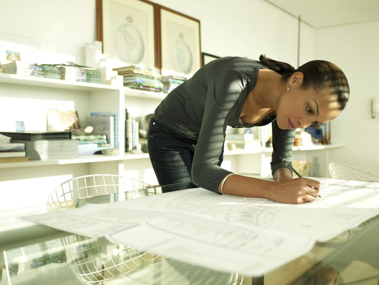 Woman working on a plan at the office