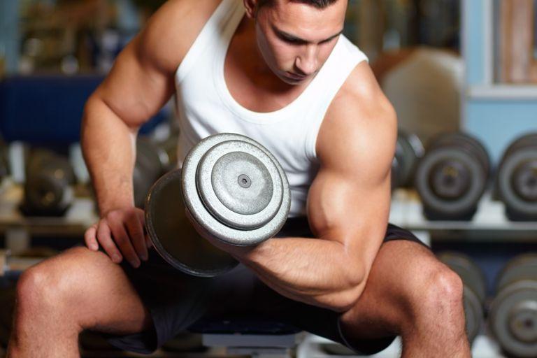 Building his biceps