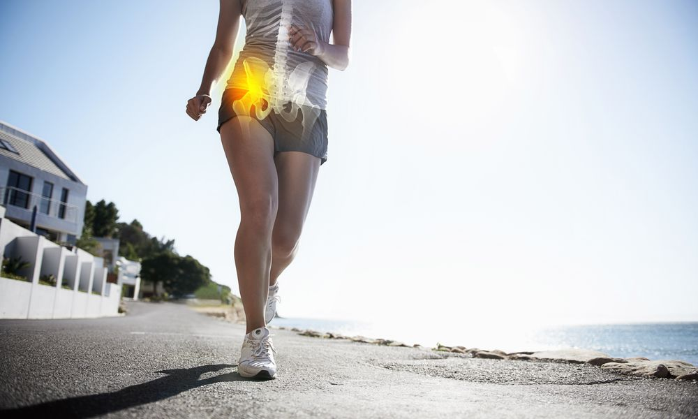 Photo of a woman running with hip pain.