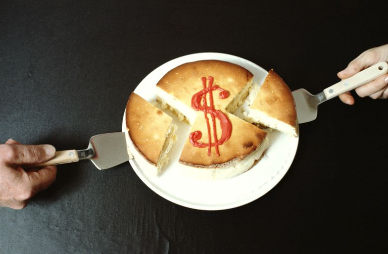 Two people take unequal slices from a cheesecake with a dollar sign on top