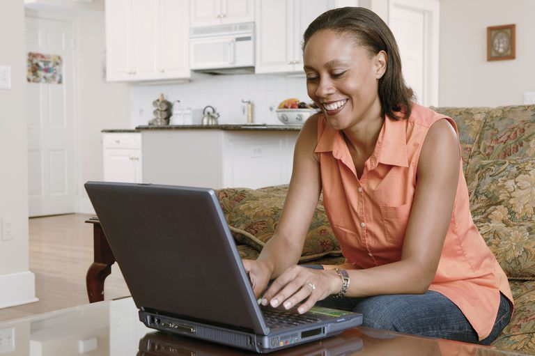 Woman using laptop on coffee table