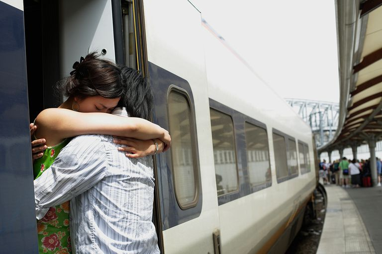 Couple Hugging by Train