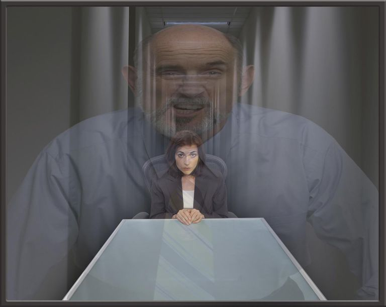 Businessman superimposed over cowering businesswoman