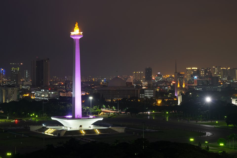 National Monument Monas with lights on in the night. Jakarta City, Indonesia.