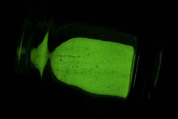 White phosphorus powder glows green in the presence of oxygen.