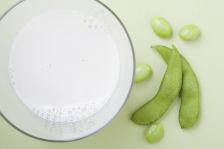 Soy milk and edamame, studio shot
