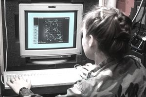 A U.S. Air Force intelligence officer with the 33rd Tactical Fighter Wing uses the Images-Many-On-Many (IMOMS) computer to assess radar threats prior to an intelligence briefing during Operation Desert Storm.