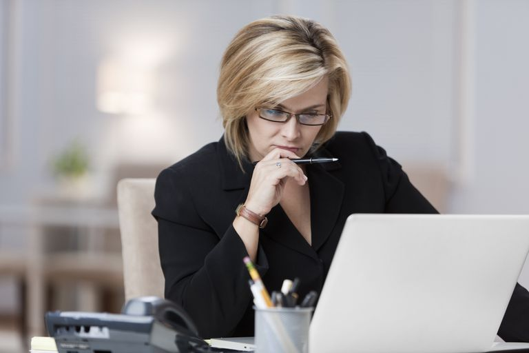 Businesswoman using laptop in home office
