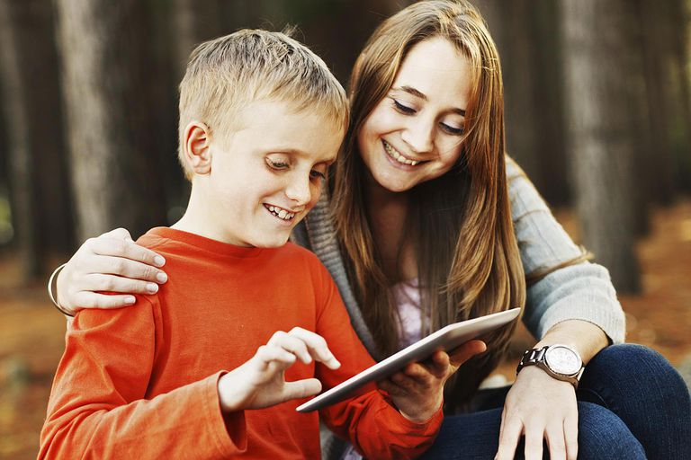 Look at that! Little boy shows woman his tablet-style pc