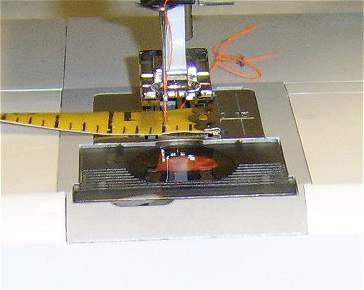 linging up the tape measure on the sewing machine