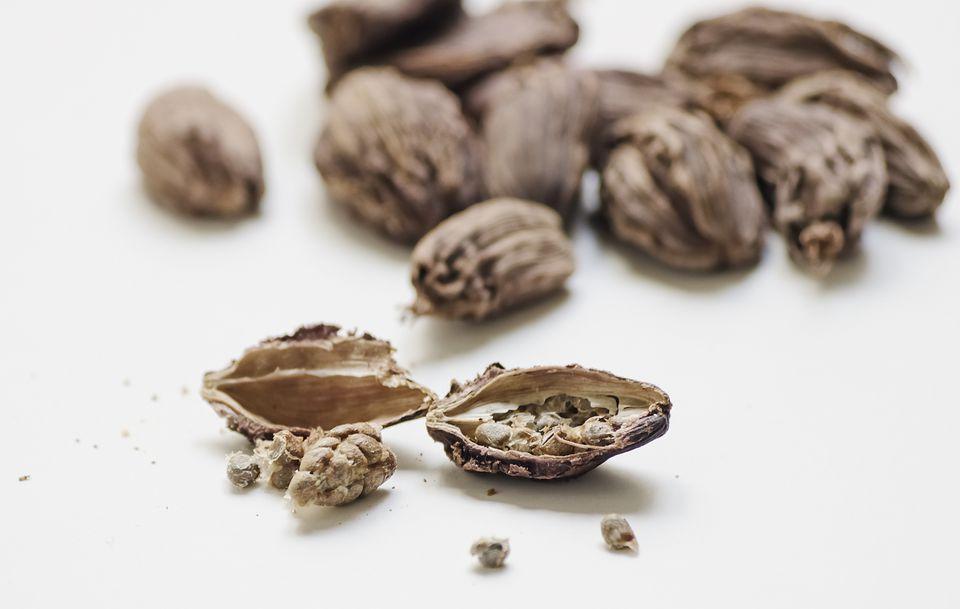 Black cardamom pods halved