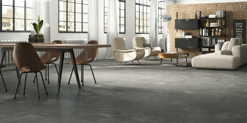 Modern living and dining room with ceramic tile floors with a concrete finish