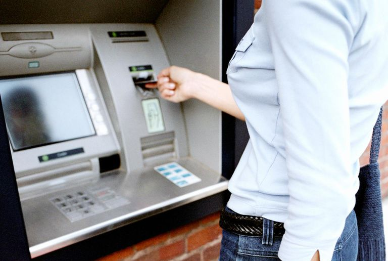 Woman using a bank machine
