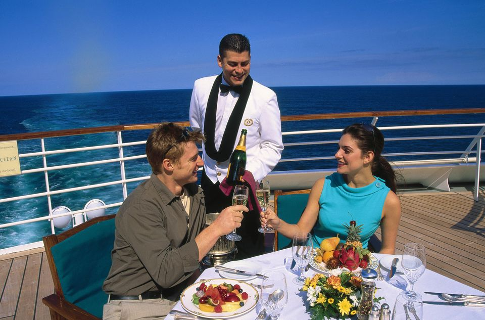 Couple eating dinner on deck of cruise ship