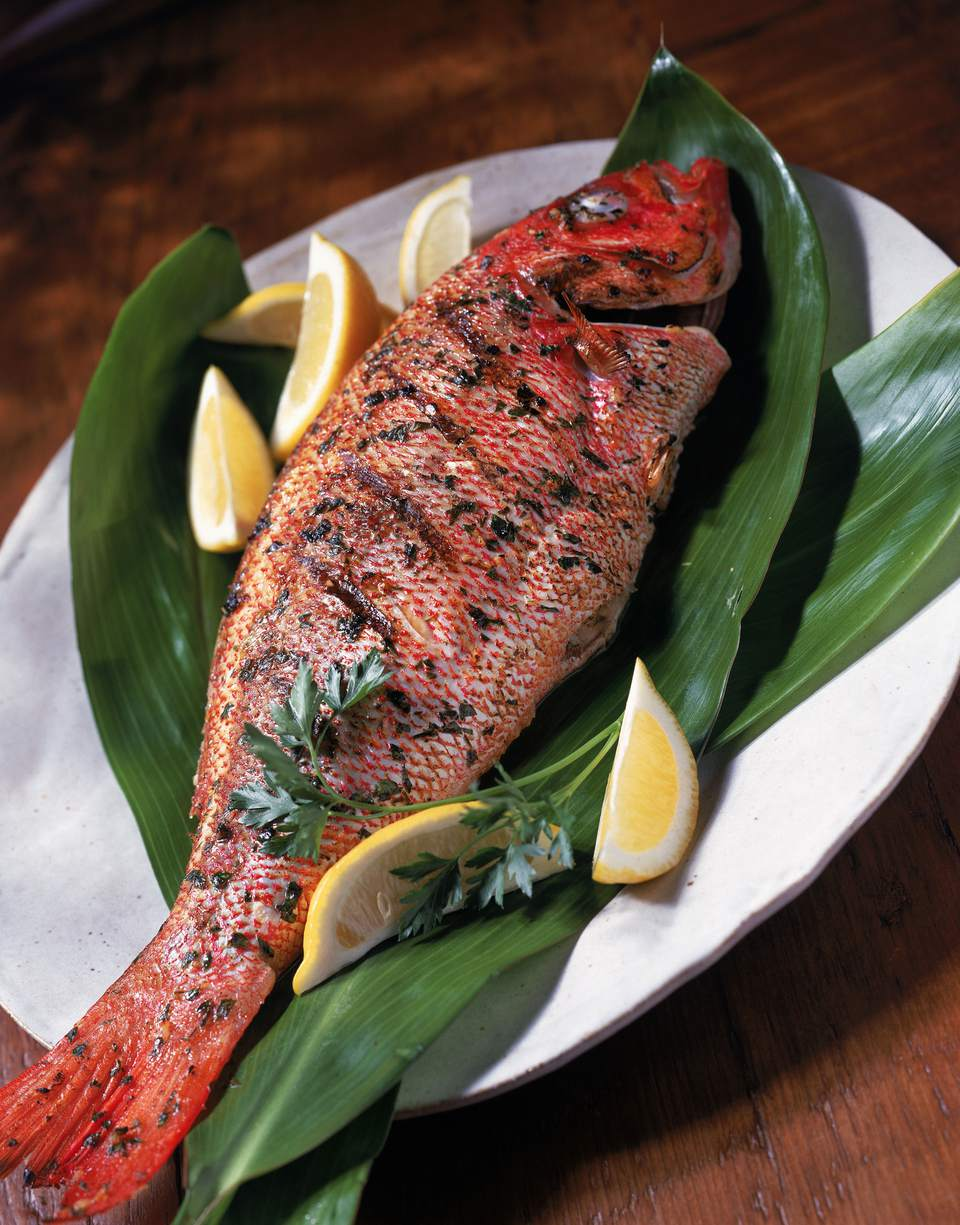 Grilled red snapper on ti leaves