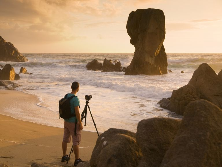 Photographer enjoying his hobby at the beach