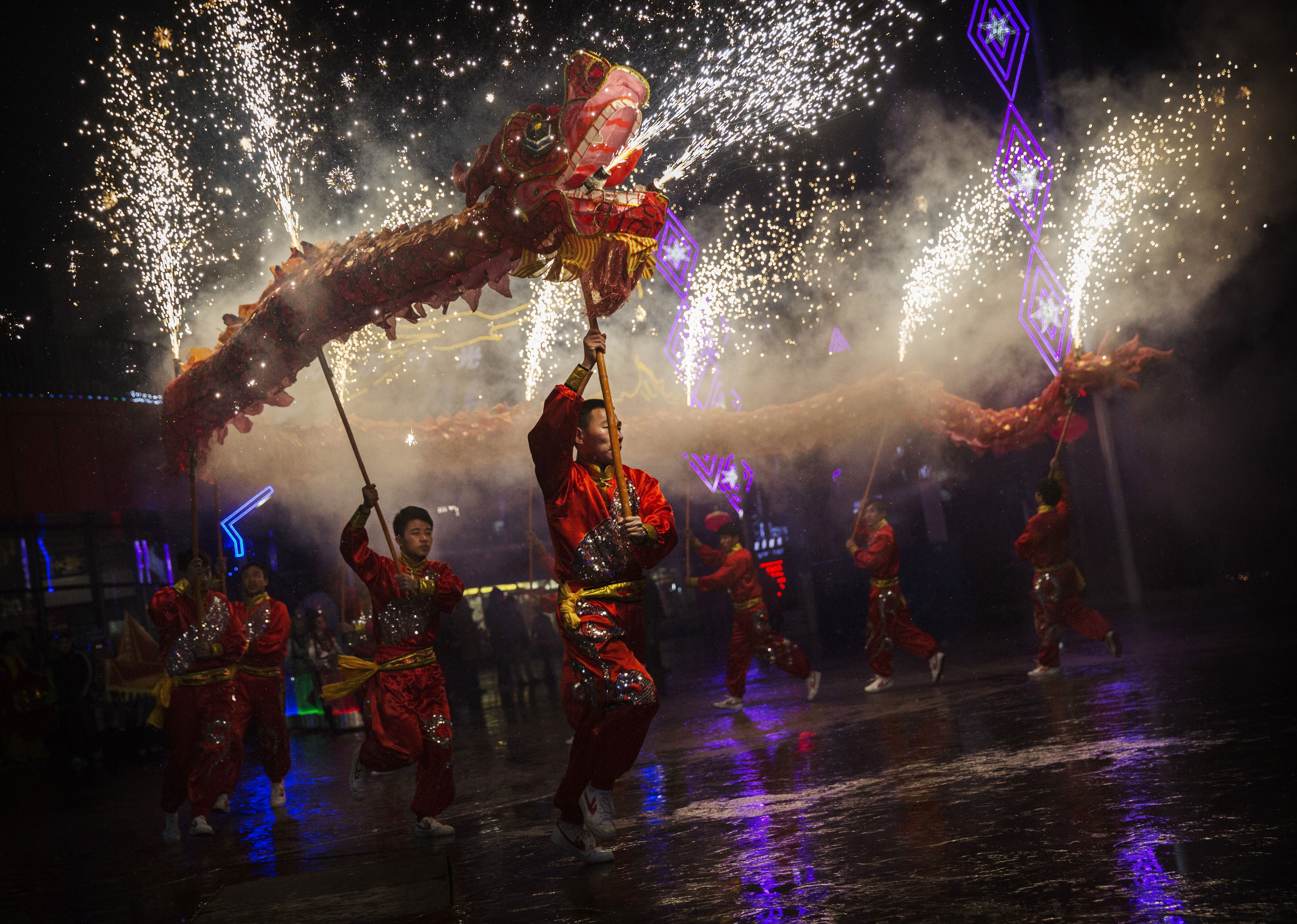 Say happy new year in chinese dancers perform a dragon dance during the chinese new year kristyandbryce Image collections