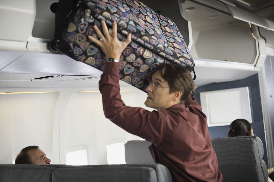 luggage in overhead compartment