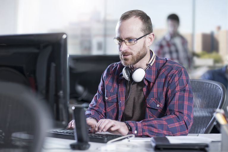 Man working on computer at desk in office