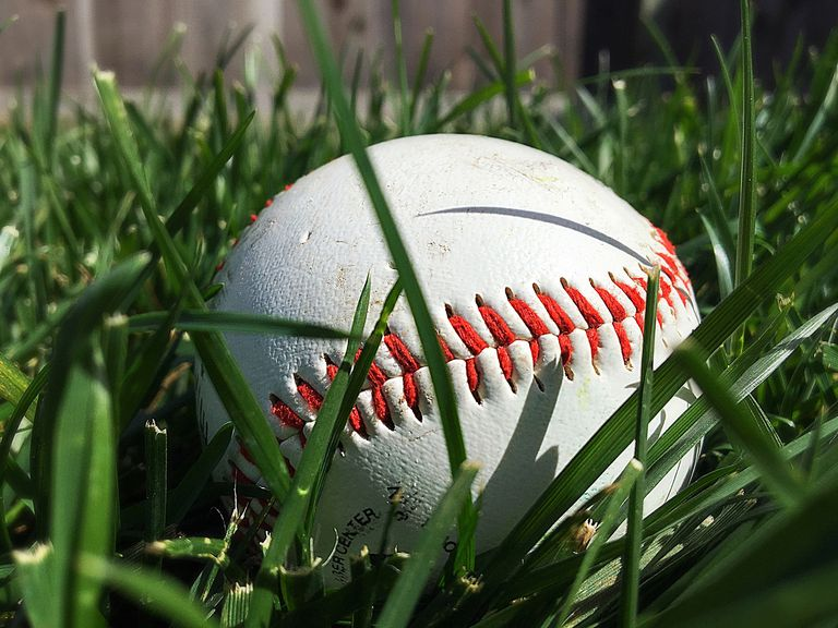 Close-Up Of Baseball In Grass