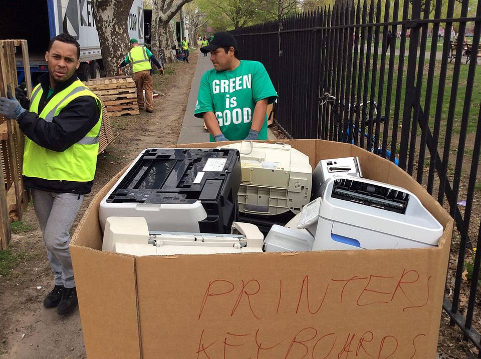 Technological waste, including printers and keyboards, being discarded at the Safe Disposal program in Brooklyn, NY