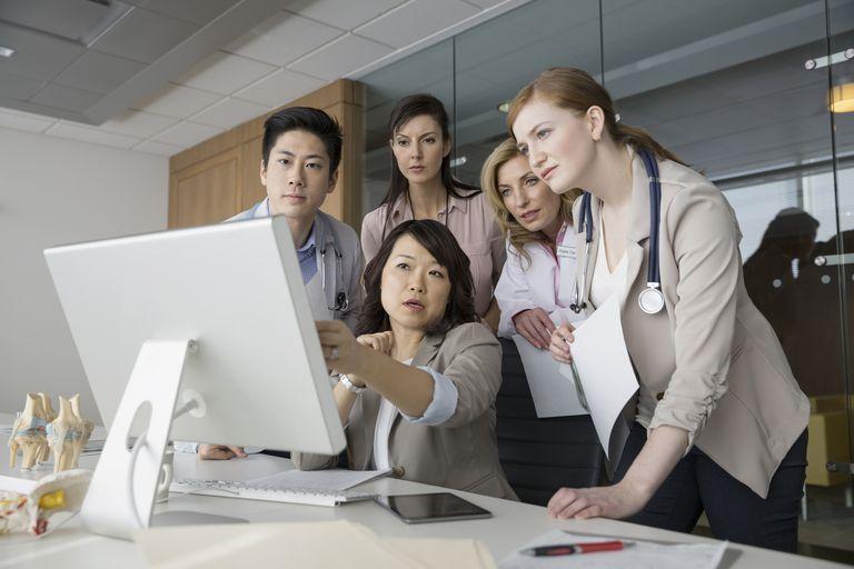 Medical Personal Looking at iMac