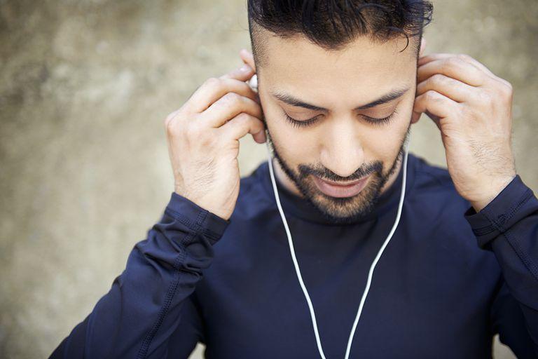 Man wearing ear buds