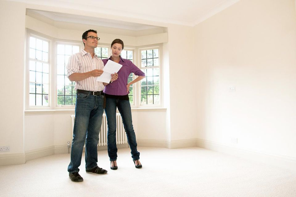 Couple look at room in vacant house