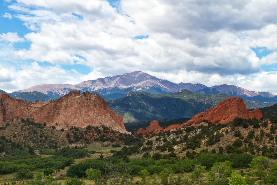 Pikes peak rises above garden of the Gods on a summer day in Colorado