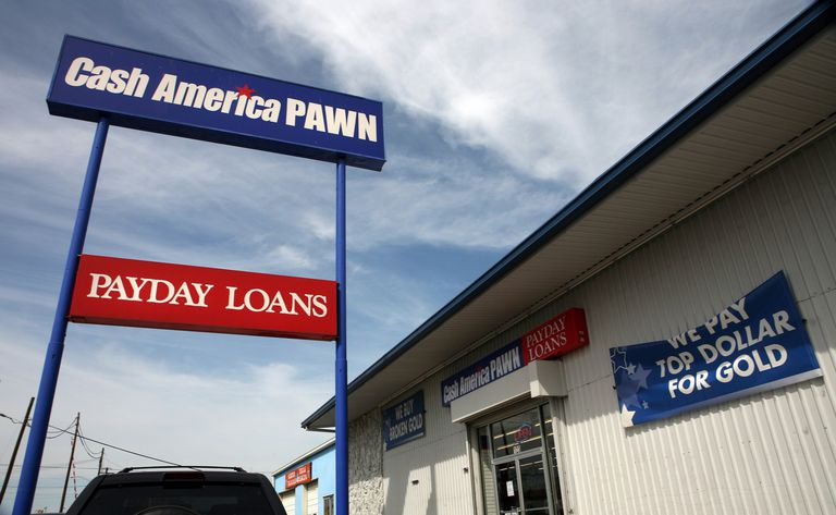 Tall pole signs advertising payday loan and pawn store