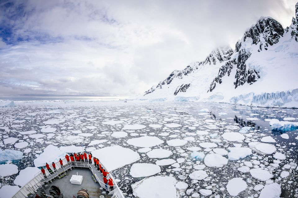 A cruise ship passes Booth Island in Antarctica