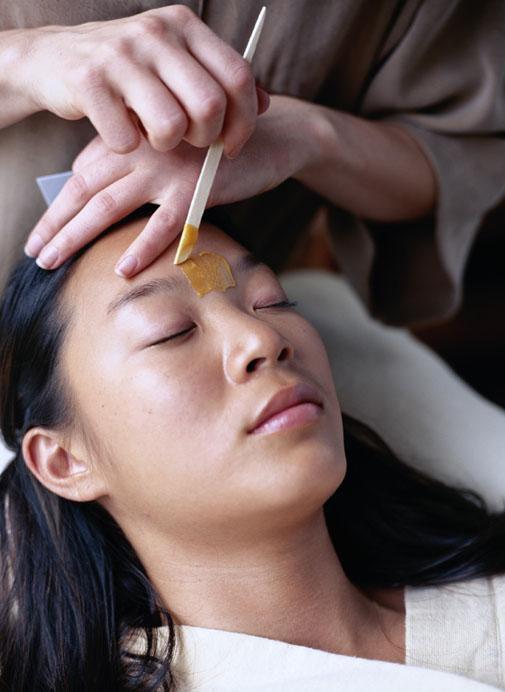 Woman getting eyebrows waxed