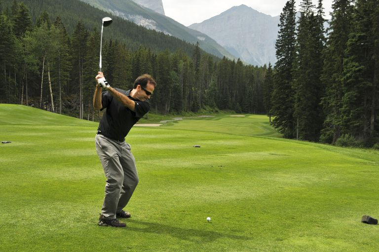A single golfer playing alone on a golf course