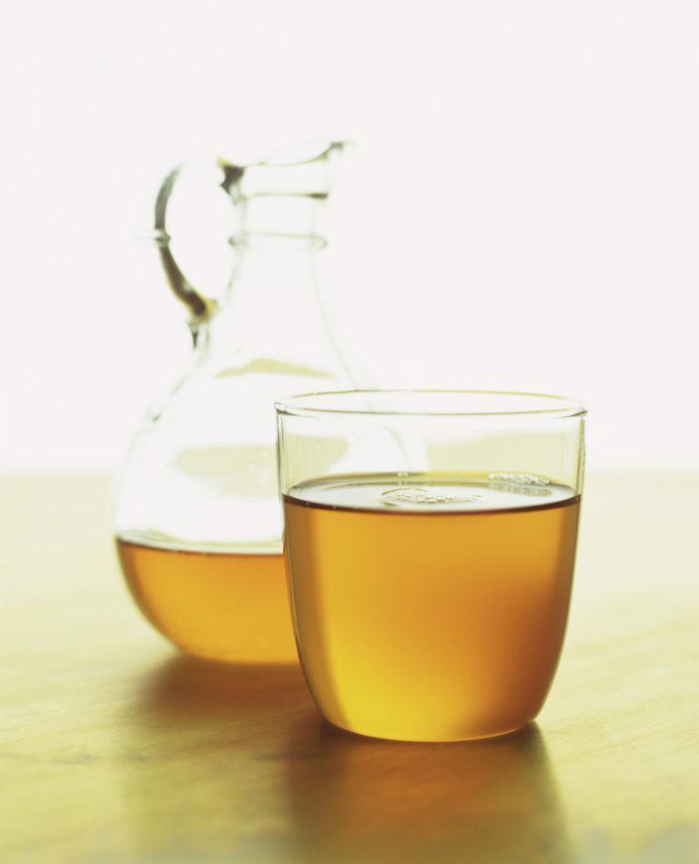 Cruet and glass of Moroccan argan oil