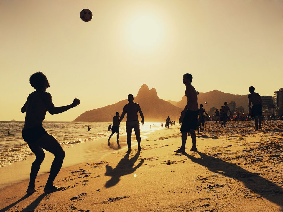 People playing football at Ipanema Beach in Rio