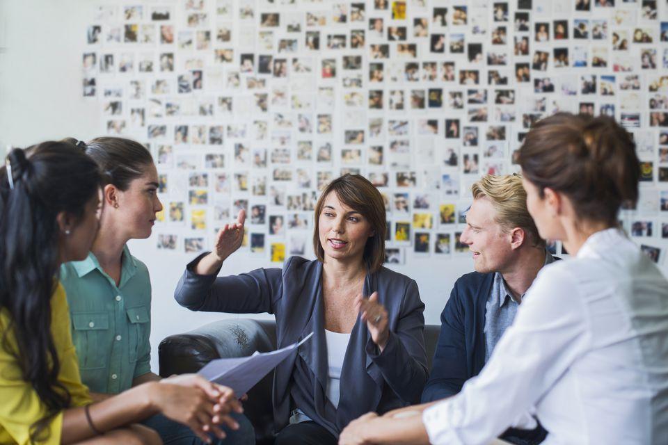 woman leading work meeting