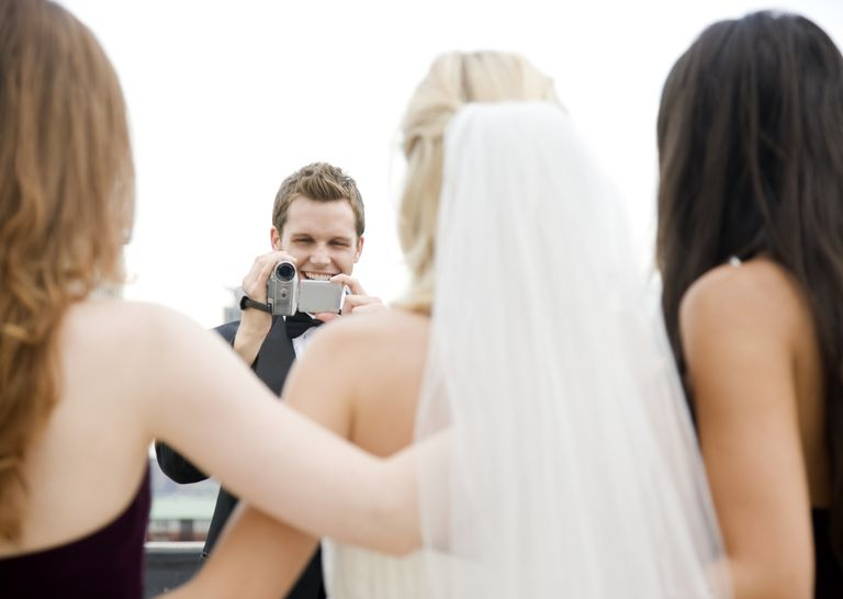 Guest taking video of Bride and her bridesmaids