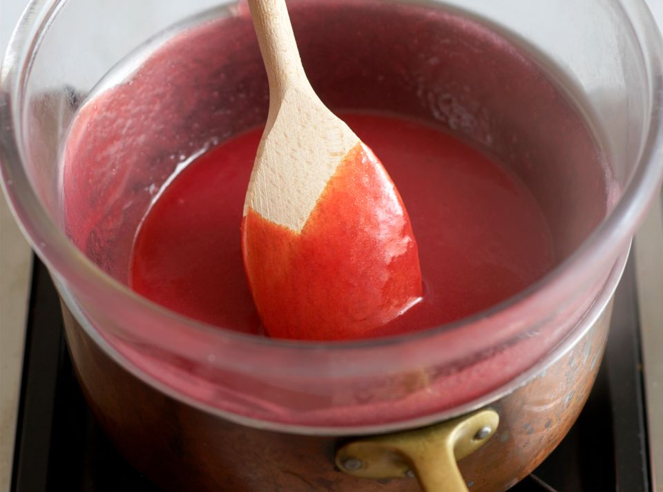 Heating raspberry curd in a double boiler