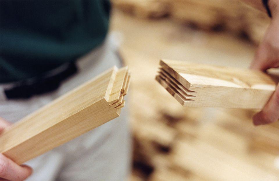 Hands Assembling Wooden Planks