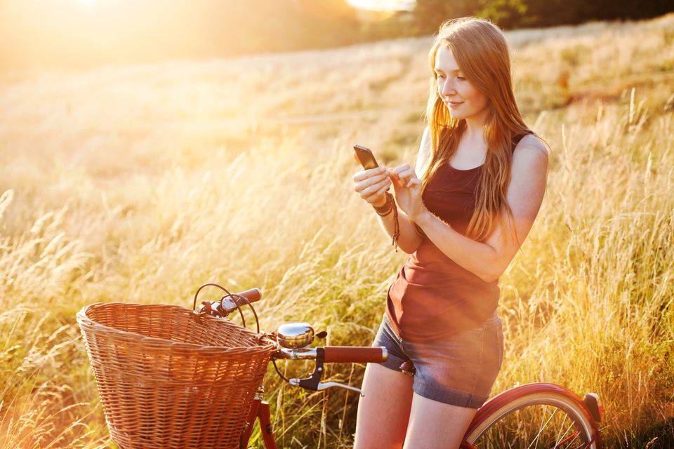 Woman on her cell phone in a field