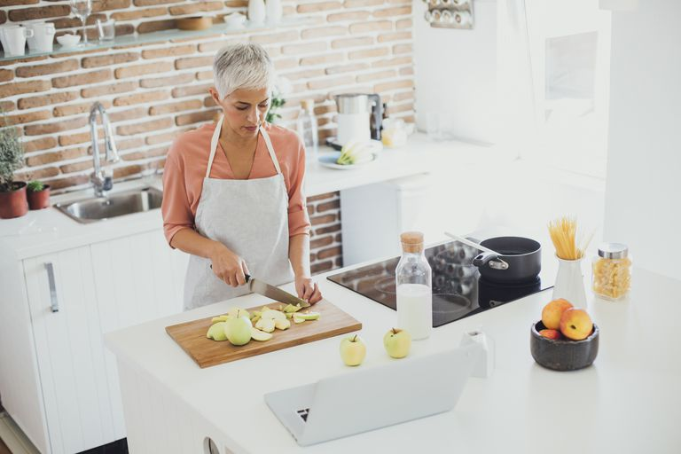 Woman preparing healthy meal in kitchen