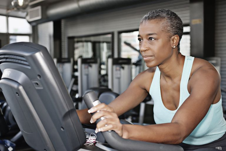African american woman on a stationary bike
