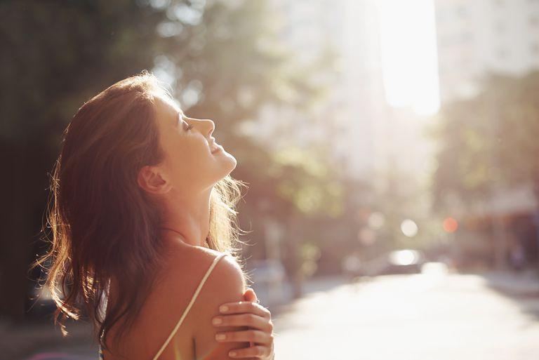 Woman soaking up sunshine