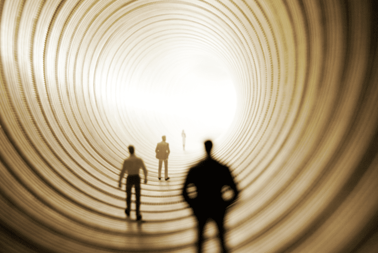 People in a tunnel of light