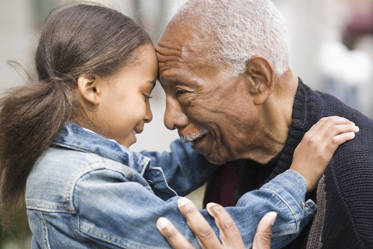 7 year old child development - girl hugging grandfather