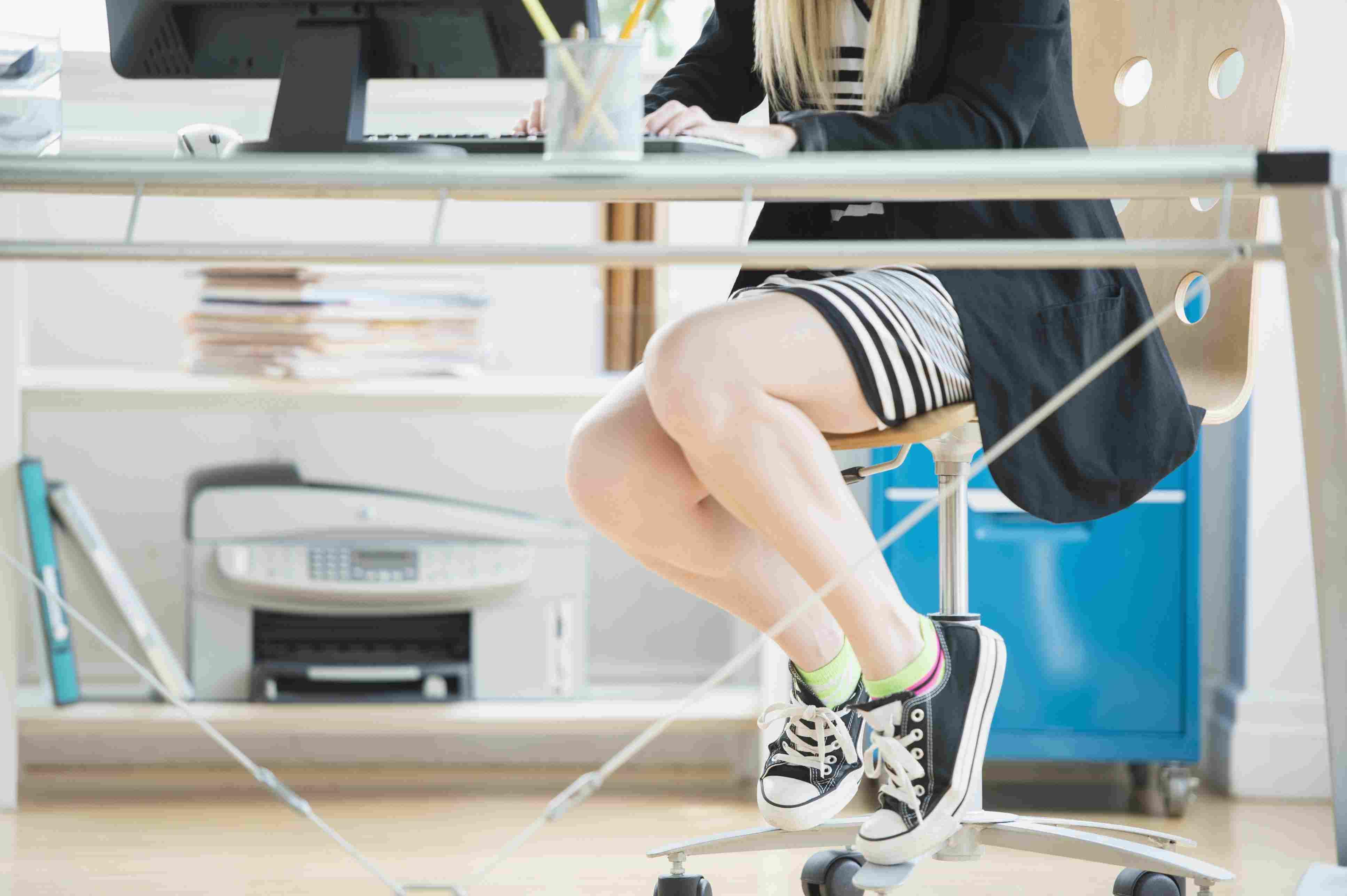 sitting desk wearing athletic shoes Jamie Grill Tetra images Getty 56a9db5f5f9b58b7d0ff8f16