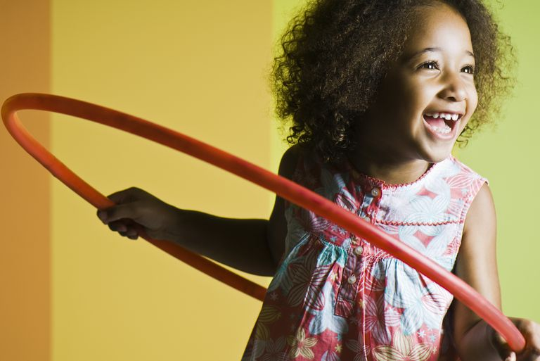 Active party game - Girl playing with plastic hoop
