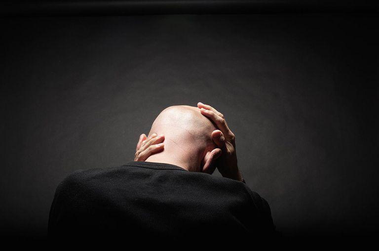 man's head on black background