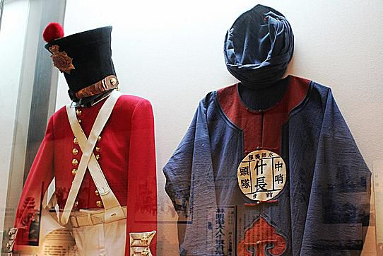 These 19th century Opium War army uniforms stand side-by-side in a Chinese museum today.