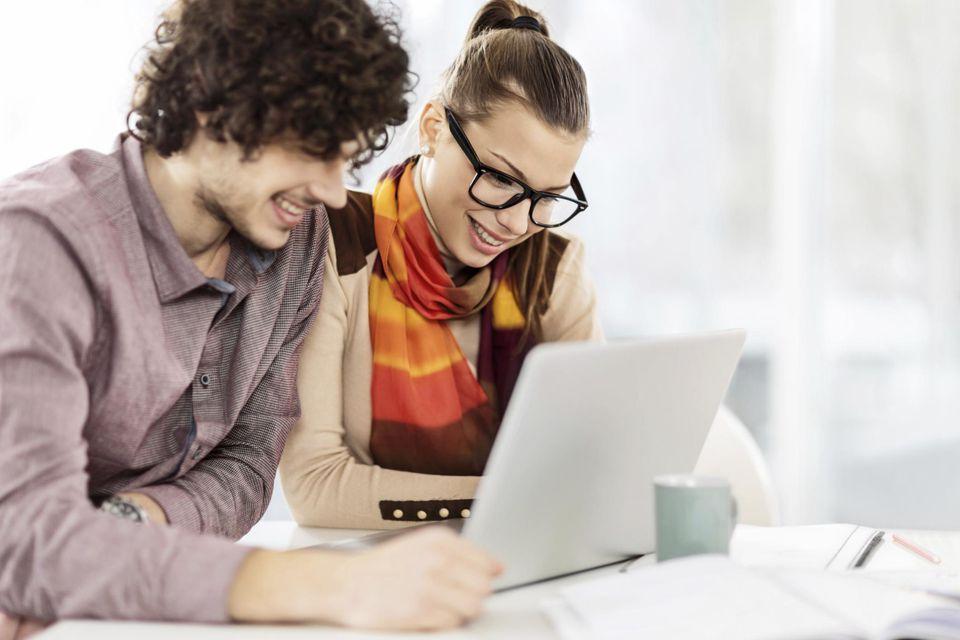 Couple using laptop.